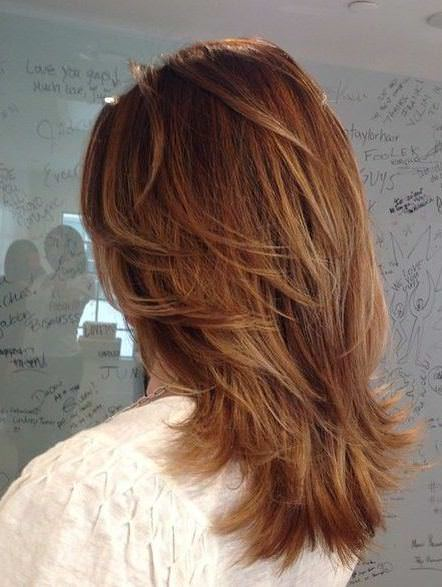 Feathered V layers medium layered haircuts