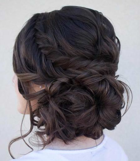 curly side bun with a fishtail braid updos for long hair