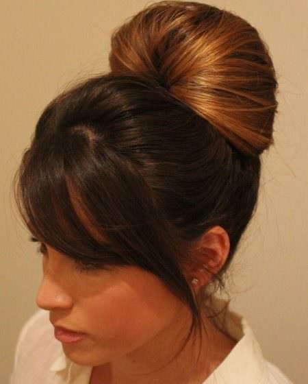 simple bun with side swept bangs updos for long hair