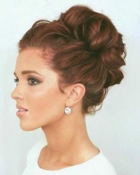High curled bun with wrap updos for curly hair