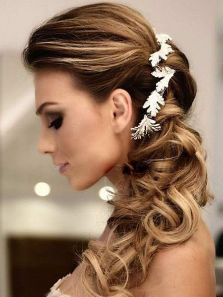 Low side ponytail with floral pieces wedding hairstyles for long hair