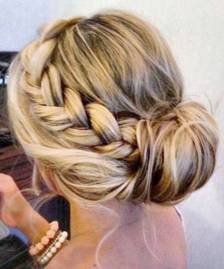 cMessy braid with crown updos for curly hair