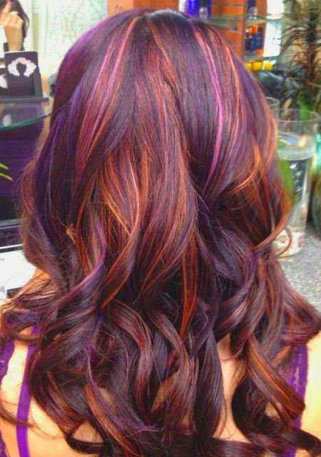 Thick waves with multicoloered highlights style curly hair