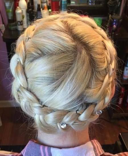 blonde crown braids with decorative pins crown braids