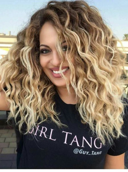 blonde waves with dark roots style curly hair
