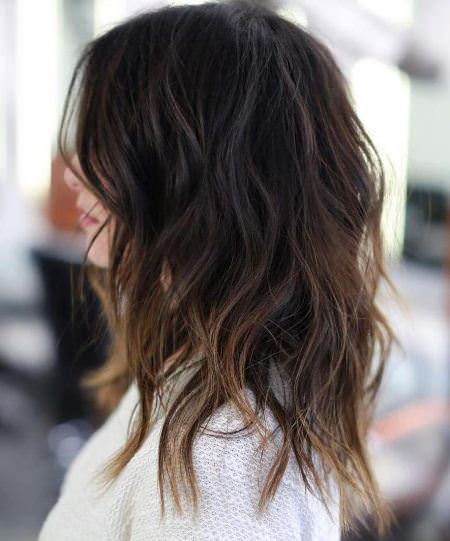 brown shag with subtle highlights style curly hair