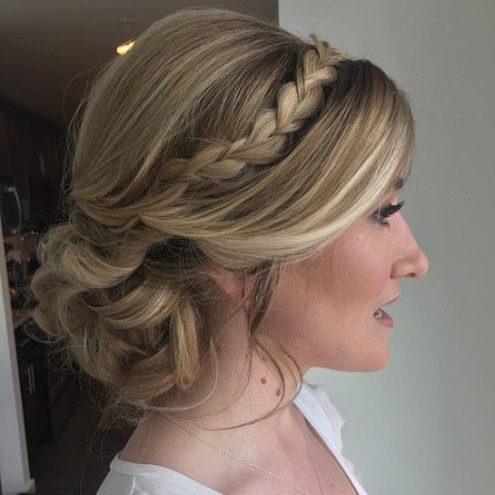 loose low updo with a braided headband hairstyles