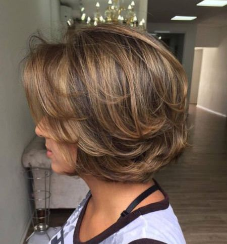 rounded bob with swoopy layers haircuts for women over 60