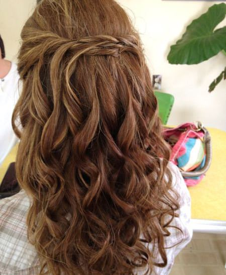 twist and pin half hairstyle style curly hair
