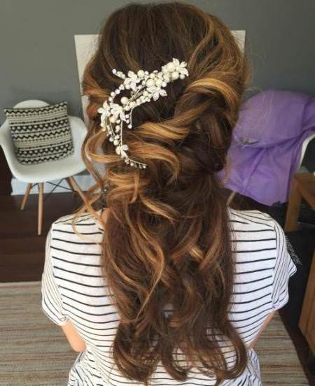Accessorized undone waves half up and half down wedding hairstyles