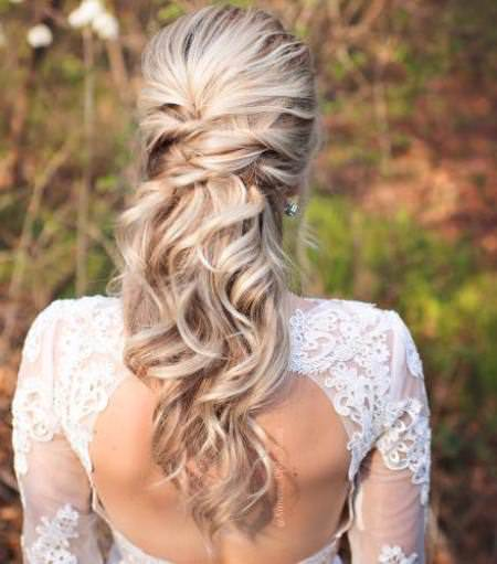 Crisscrossed half wedding hairstyle half up and half down wedding hairstyles