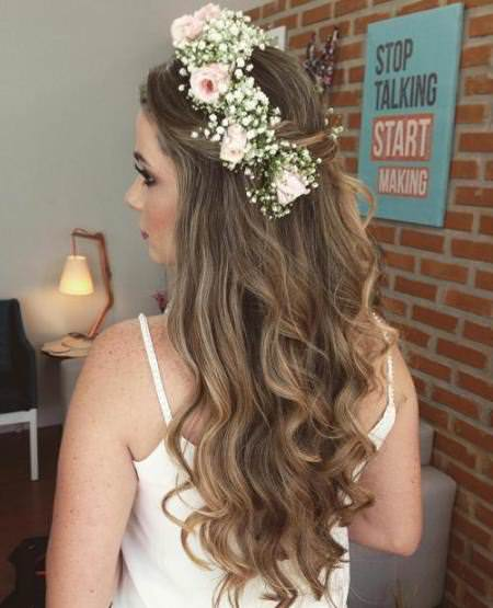 Floral crown half up and half down wedding hairstyles