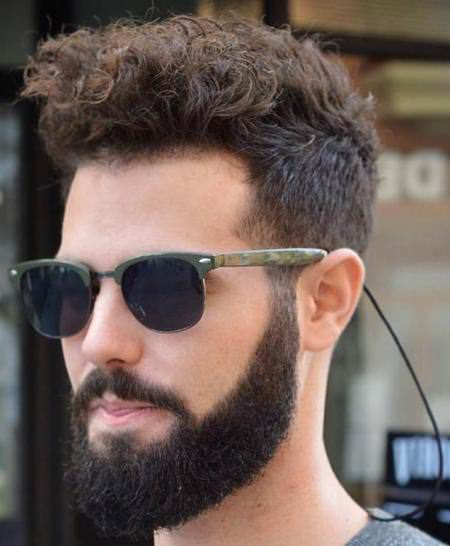 Long curly top and short sides hairstyles for men with thick hair