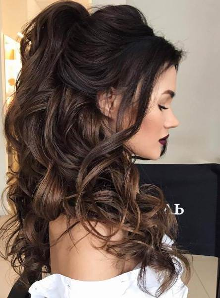 Voluminuous half ponytail half up and half down wedding hairstyles